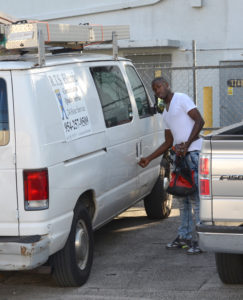 An RTS Electric employee outside Worldwide Primates in Doral, FL